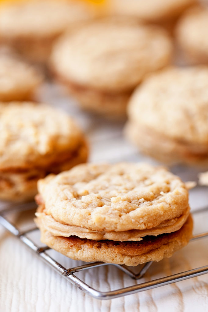 Soft peanut butter oatmeal cookies with a luscious peanut butter cream filling. Girl Scout copy cat cookies, but even better!