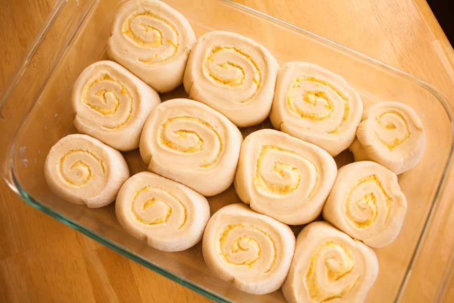 Want orange rolls, but don't have the time? With this recipe, now you do! All it takes is a single 30-minute rise in the pan and you have fluffy rolls fast! This step-by-step tutorial with pictures shows you just how easy it is!