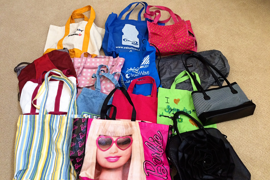 """Are you secretly a """"bag lady?"""" You don't have to be! Learn once and for all how to choose which bags to keep and how to store them for easy access!"""