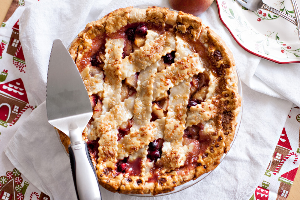 Pear Cranberry Almond Pie. The best holiday pie you will ever eat! The perfect pie recipe for pears and cranberries. Such a beautiful dessert!
