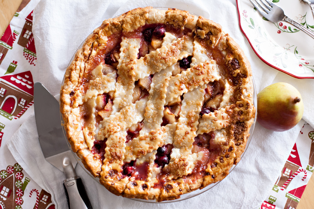 Pear Cranberry Almond Pie. The best holiday pie you will ever eat! The perfect pie recipe for pears and cranberries. Such a beautiful dessert! Pear Pie, Cranberry Pie, Almond Pie, Christmas Pie.