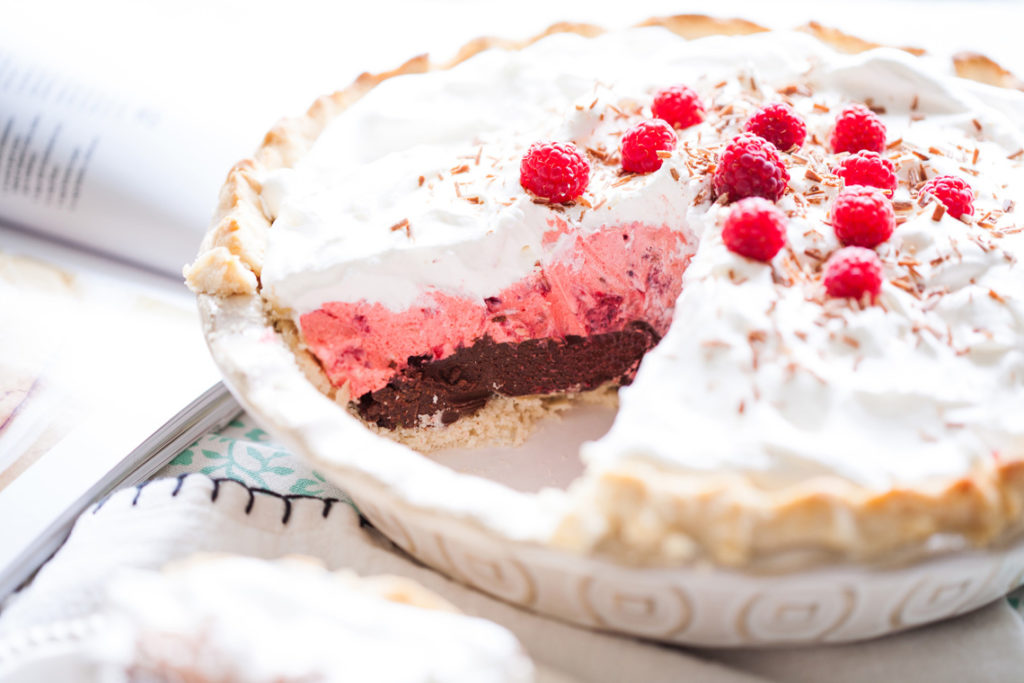 A layer of thick, dark chocolate covered with light raspberry cream. Top with whipped cream and fresh raspberries, and you have a show-stopping dessert! Raspberry Pie, Dark Chocolate Raspberry Pie, Raspberry Cream Pie, Valentine's Pies, Valentines' Day Pies