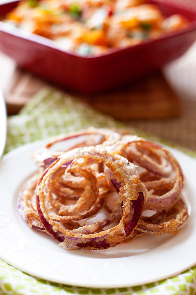 These red onion rings are light and crispy and flavorful! These perfectly pair with a tasty burger! Or eat them alone! You won't be able to stop! Fried onion rings. Crispy onion rings. Homemade onion rings.