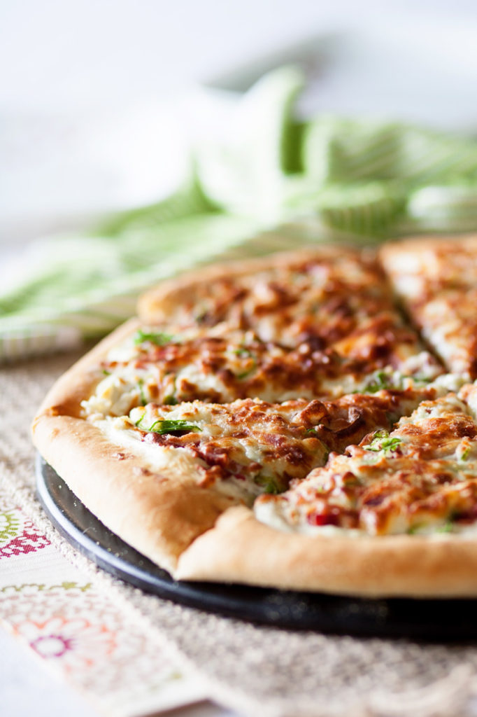 If you love pizza and you love jalapenos, then this Jalapeno Popper Pizza is the perfect pizza for you! Topped with jalapenos, cheese, bacon and onions, it's an amazing appetizer or dinner! Perfect pizza dough, jalapeno pizza, pizza recipe