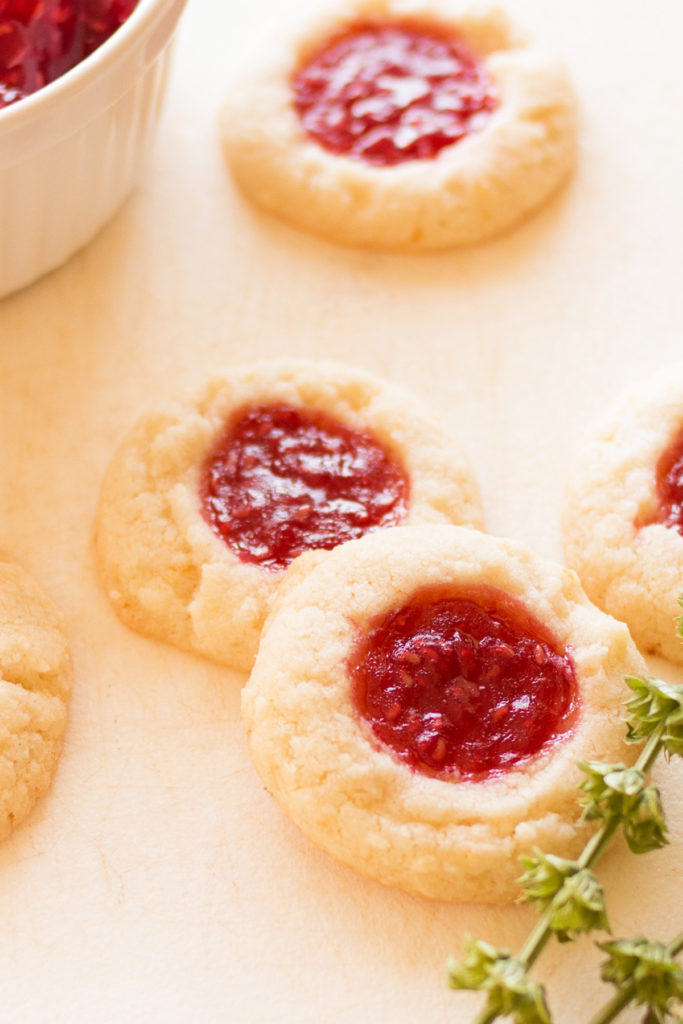 Take the best lemon butter cookies recipe and dress it up with some gorgeous, tasty raspberry jam! This recipe for Raspberry Lemon Butter Cookies is the best ever!