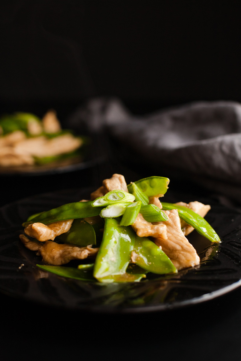 Chinese Pork Stir Fry with Snow Peas! Tender pork, crispy snow peas, and a delicious sauce all combine to make this dish a hit!