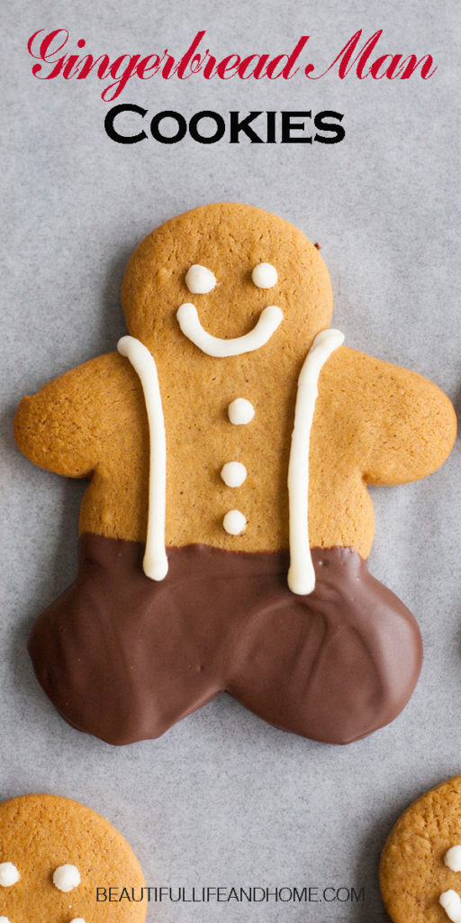 """These gingerbread man cookies are so adorable and delicious! Inspired by Kneaders Gingerbob cookies, they are big, soft gingerbread cookies dipped in chocolate and decorated with buttons and suspenders! Add this gingerbread man recipe to your holiday list of """"must-makes!"""""""