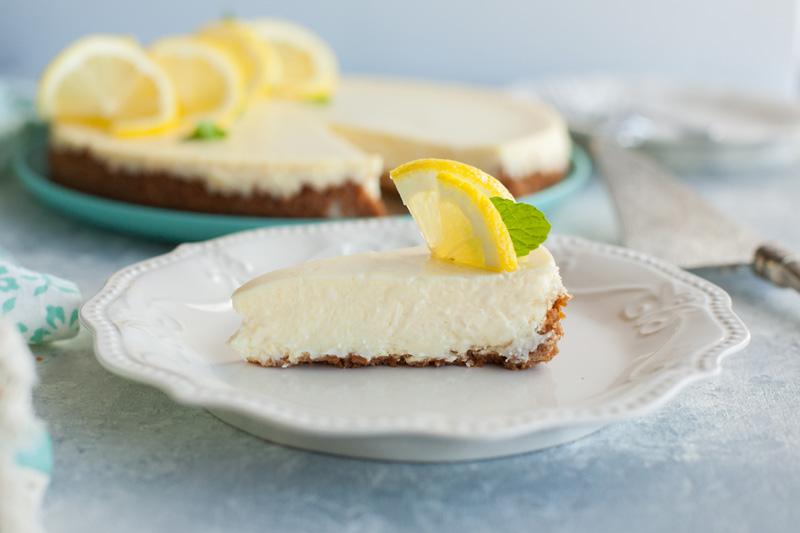 slice of lemon cheesecake with graham cracker crust